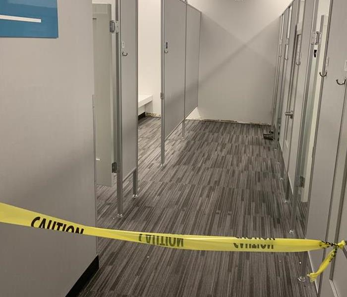 Hallway taped off with caution tape.