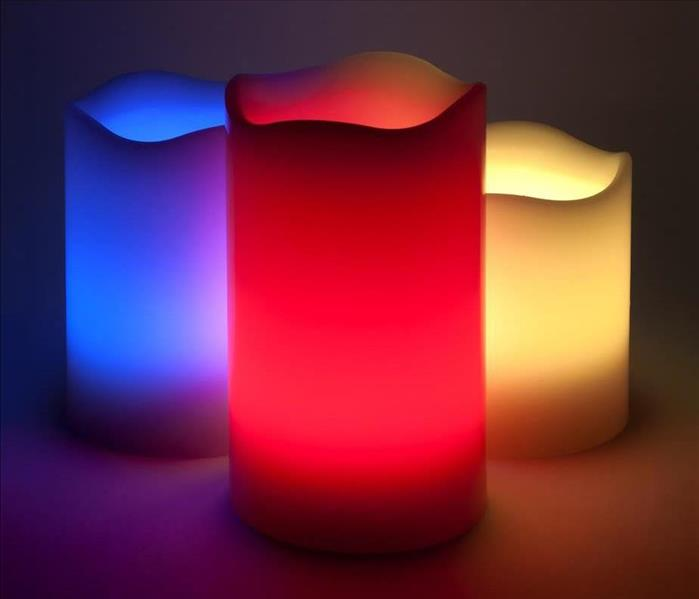 3 LED candles. One is red, one is blue, one is yellow.