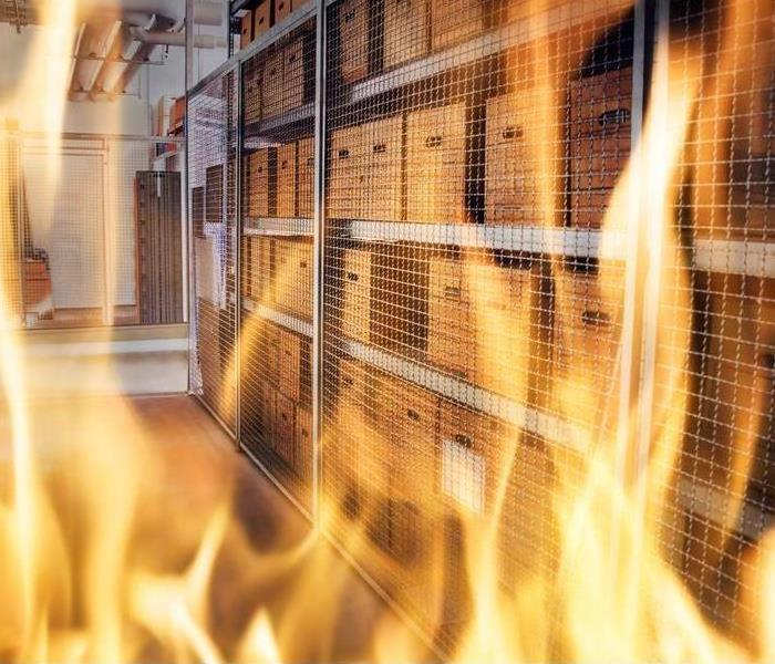 Flames in a commercial facility with storage boxes
